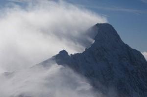 Aerial view of snowcapped Capitol Peak in Colorado's Elk Mountains