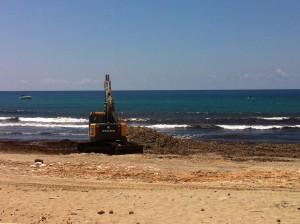 ruspe al lavoro nella spiaggia di Cornino, Trapani